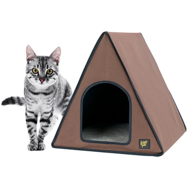 Front view of outdoor heated cat house with cat