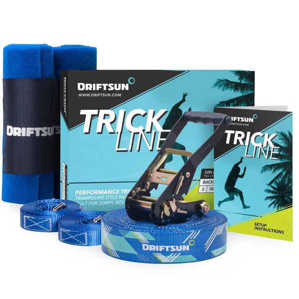Complete Driftsun slackline trick line set layed out including the webbing, ratchet, tree guards, instruction manual, and packaging