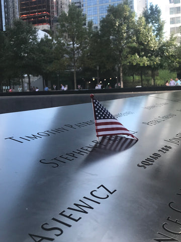 Names on 9/11 Memorial with USA Flag