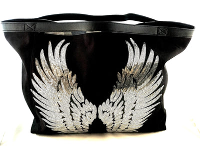 Black travel tote bag with leather handles and angel wings