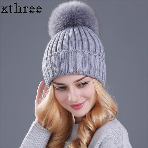 XTHREE Knitted Beanie with Faux Fur Pompom