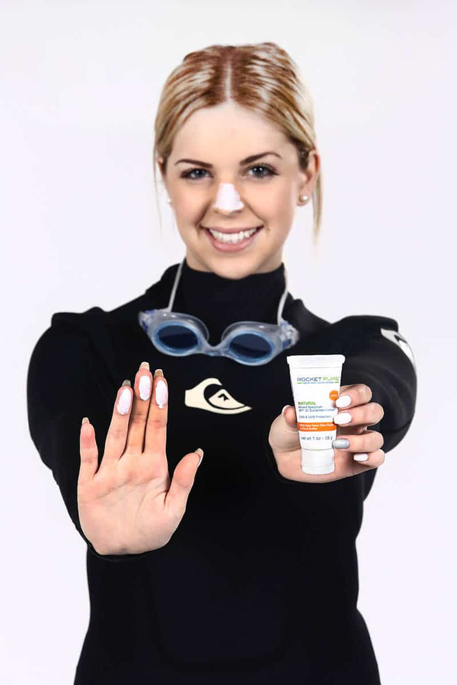 Applying Rocket Pure SPF 30 Zinc Sunscreen by swimming athlete