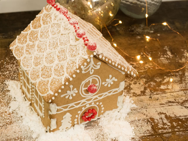 Decorated gingerbread house kit with minimal design