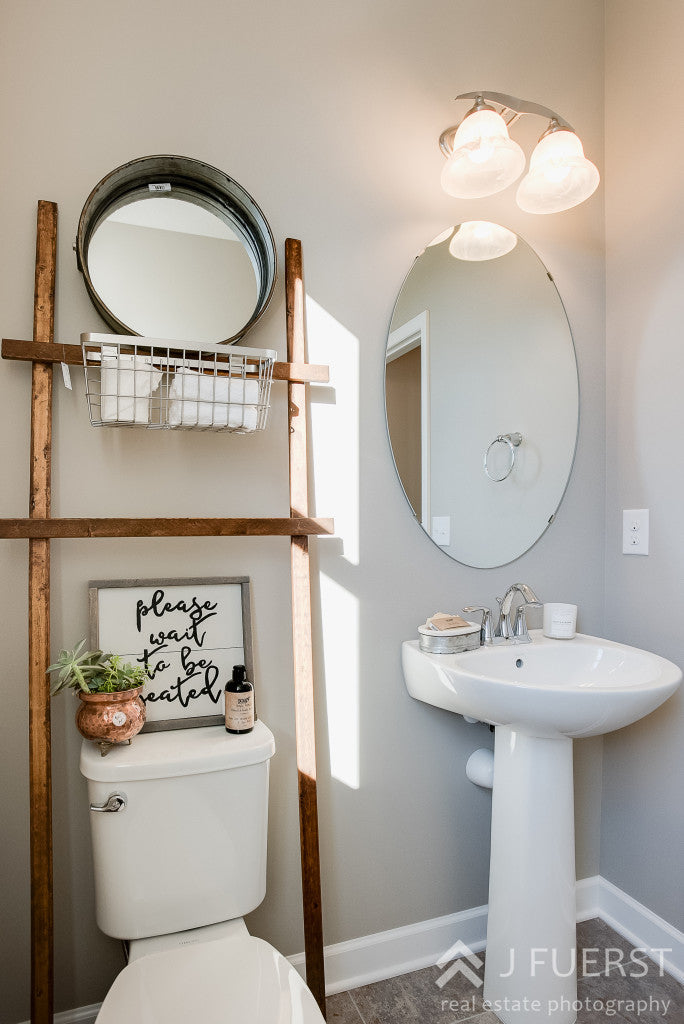 Modern Fall Farmhouse | Drum Mirror | toilet ladder | please wait to be seated sign | copper accents | bathroom decor | farmhouse bathroom |cjc@home | Carver Junk Company's Staged Home Shopping Event | Victoria, MN | Home Staging | Modern Fall Farmhouse | Fixer Upper Style | carverjunkcompany.com