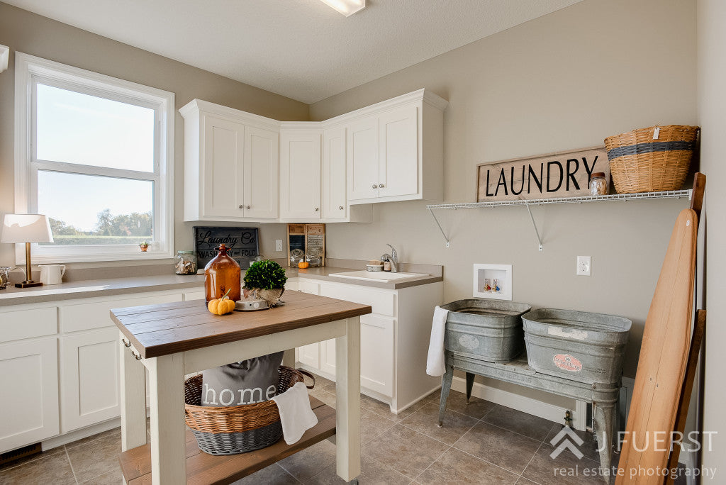 Modern Fall Farmhouse | laundry room | laundry wood handpainted sign | center island |cjc@home | Carver Junk Company's Staged Home Shopping Event | Victoria, MN | Home Staging | Modern Fall Farmhouse | Fixer Upper Style | carverjunkcompany.com