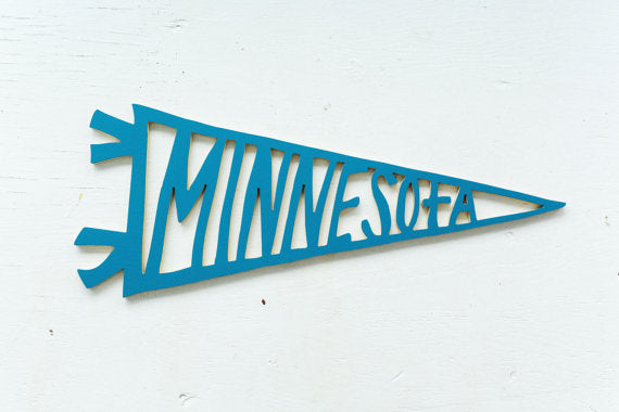 Minnesota Baseball pennant in a variety of colors. Handmade in Minnesota, handpainted and perfect for your favorite sports fan or Minnesotan. Carver Junk Company stores or online at carverjunkcompany.com. $35 Each one will vary slightly. 2016 Holiday Gift Guide