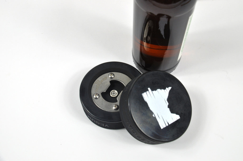 Hockey Puck Bottle Opener, made with a real hockey puck. Distressed Minnesota design, and the opener is inset, so puck can be used for a real game! Holiday 2016 gift guide.