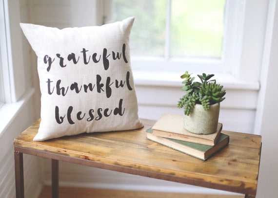 Grateful Thankful Blessed handpainted linen pillow, includes insert. Carver Junk Company stores or online at carverjunkcompany.com. $35 Each one will vary slightly. 2016 Holiday Gift Guide