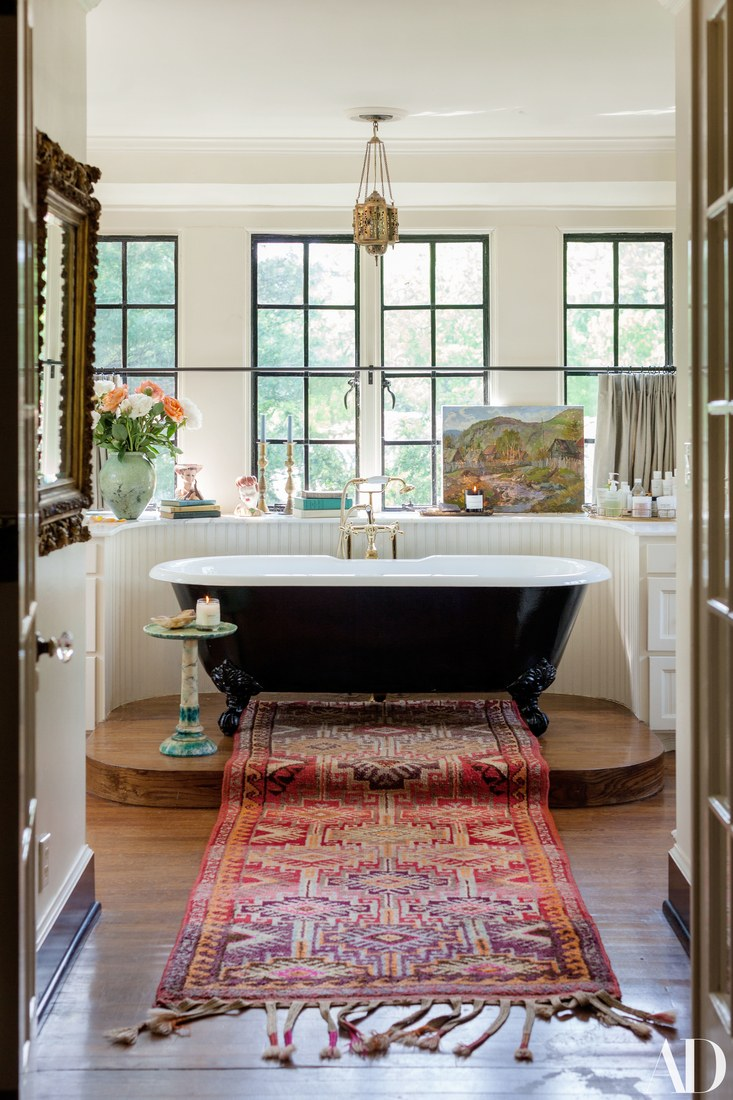 Vintage Bathroom with Clawfoot tub and chandelier designed by Pierce and Ward