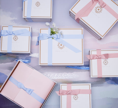 Blue and pink gift boxes Taken Care Of