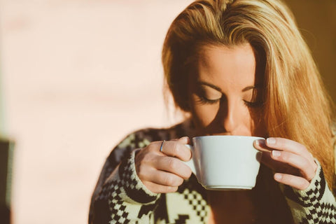 woman drinking her favourite coffee