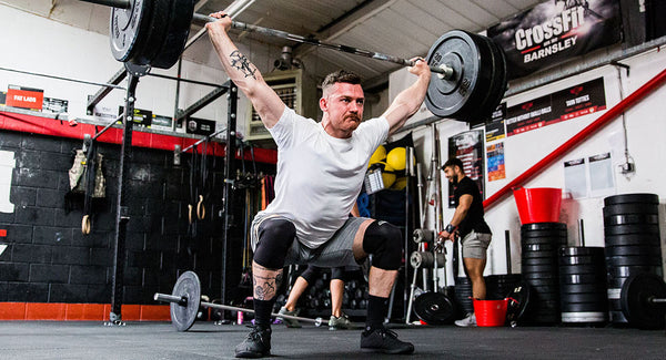Overhead squatting in knee sleeves