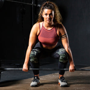 Woman lifting crossfit camo knee sleeves