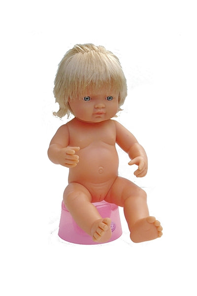 A potty training doll on a doll's potty seat