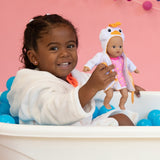 A Black Child Model holds Adora Doll Baby tots Ducky Bathtub doll