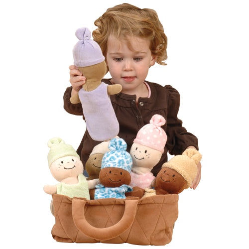 a little girl playing with her basket of babies educational activity toy