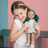 A young model showing the Hispanic / multicultural / biracial doll Alma from Adora