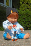 Here's our little redheaded boy doll from Miniland Educational in his criscross 4 pc clothing set