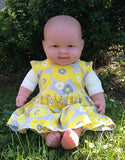Cuddle Me Life-sized doll in real baby's dress size 3-6 months