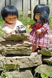 An Asian Boy Doll and an Asian Girl Doll modeling their doll clothes for 15 inch dolls