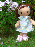 Our new Green Garden soft doll and lovey posed in the garden