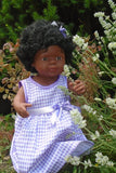 lifestyle photo of Jazz, our beautiful 15 inch Black Baby doll