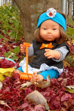 a lifestyle photo of Cheryl our new down syndrome girl doll