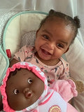 Here's ahappy customer provded picture of her child and lil hugs doll