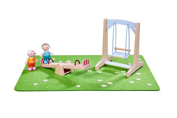 HABA's little friends playground set has 2 dollhouse dolls a swingset see-saw and playmat