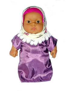 a multicultural baby doll in a hajib and abaya