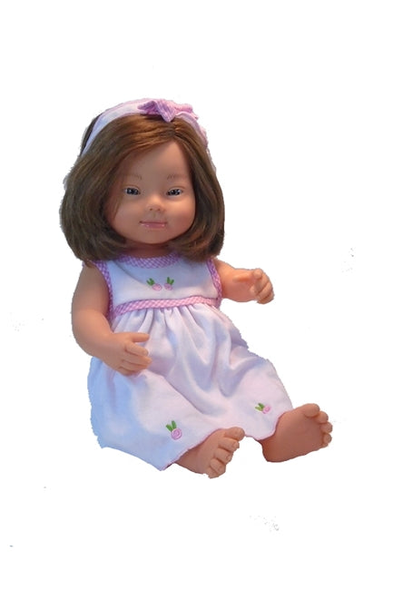 Cheryl Down Syndrome Doll in a sleeveless knit doll's dress