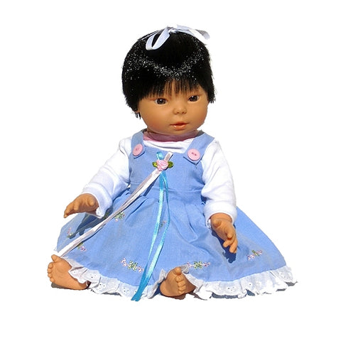13 inch all vinyl Asian baby doll with hair in beautiful dress