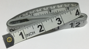 Universal Tape Measure metric and imperial measurements on one side and inches on the other. Tailoring, Dressmaking, Design