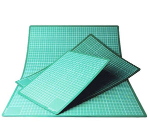 Olfa self-healing cutting mats designed to take the wear and tear that your rotary cutting blades