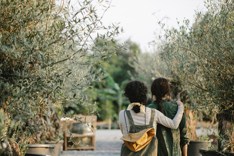 two people stood hugging in a garden