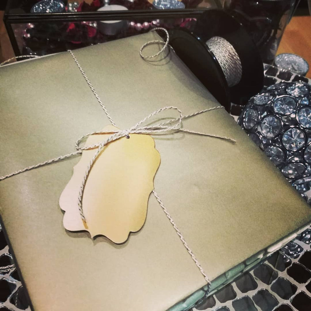 Gift box wrapped in Kraft Gold Gift Wrap