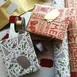 Two Gift Boxes wrapped in Stocking Green & Merry Red Gift Wrap