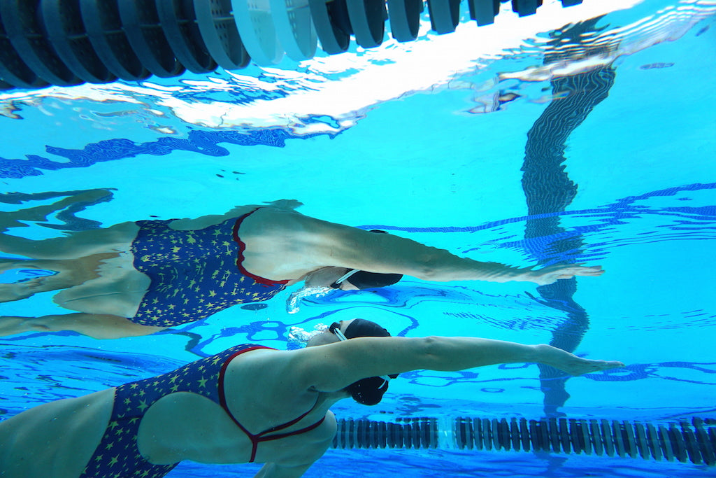 Olympian Kaitlin Sandeno High Five Reflection Underwater Swim Laguna Fin