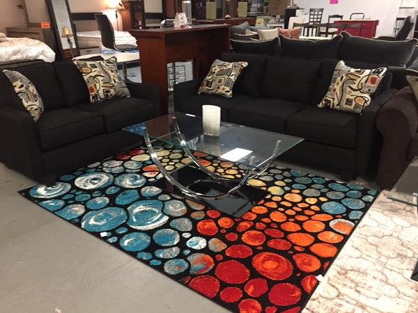 black sofa and loveseat with colorful pillows – Sunshine Furniture ...