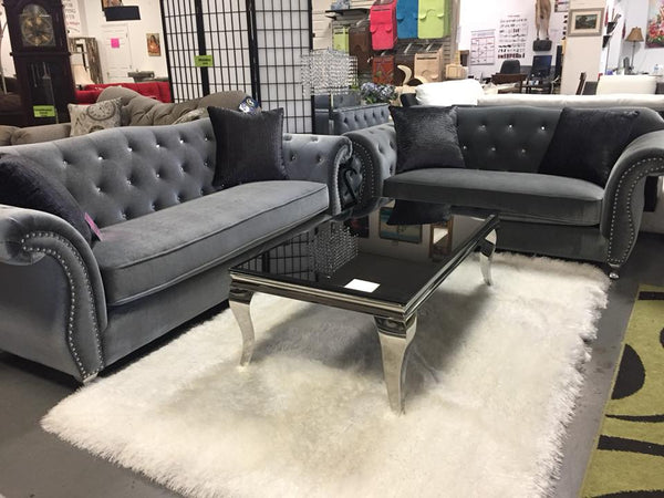 grey tufted velvet sofa and loveseat with rihnstones and nail head trim