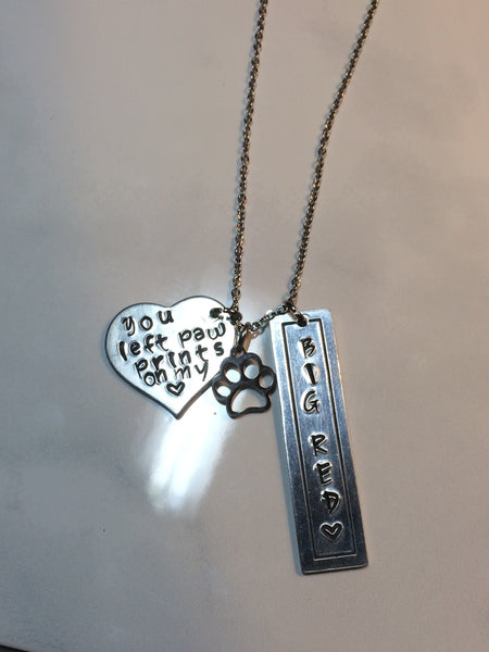 """You Left Paw Prints on My Heart"" Treasure Necklace with Name Bar and Paw Print"