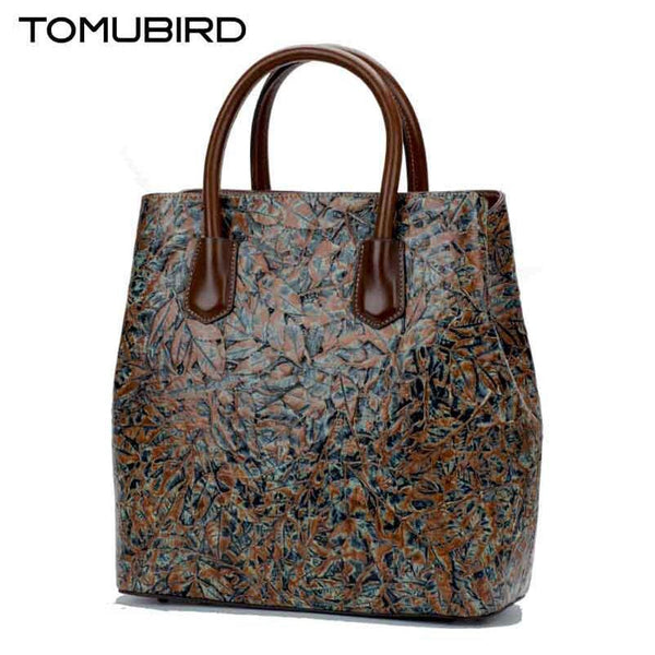 Embossed genuine leather handbag