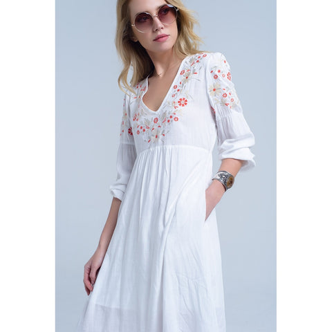 White tunic dress with embroidered flowers