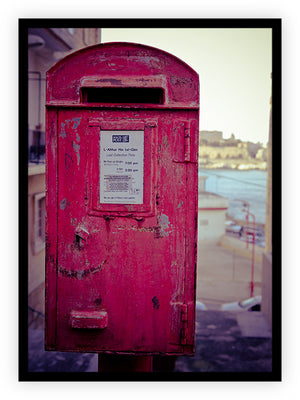 A Red Postbox by the Water