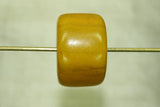 Pale yellow amber cylindrical bead