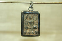 Small Metal Buddhist Pendant