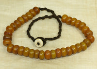 Strand of Small Imitation Amber Beads from Nepal