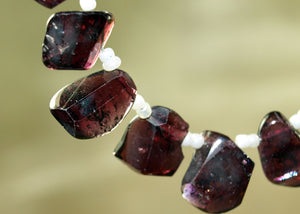Strand of One-Sided Faceted Garnet Beads