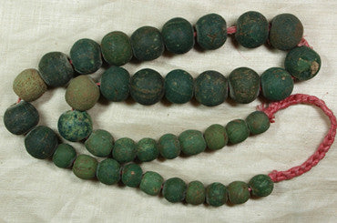Impressive strand of Chartreuse and Teal Majapahit beads
