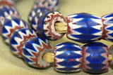 Strand of antique mixed Blue Chevron beads